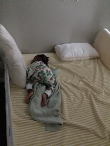 Sleeping her big bed now